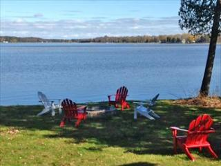 Views of Crooked Lake can be seen throughout the home and yard