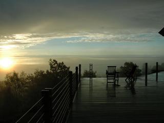 Sunrise Summit With A Foggy Sunrise