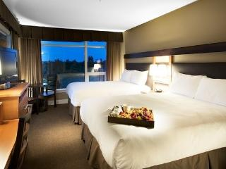 This beautiful suite is furnished with two plush pillow-top queen-sized beds.