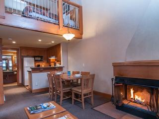 Relax with friends or family by the wood-burning fireplace in the spacious living area