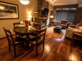 This chic condo boasts stunning hardwood floors and a beautiful rock fireplace.