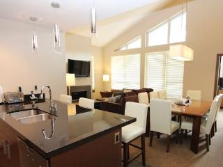 Gorgeous vaulted ceilings and a spacious living area make this condo perfect for a family.