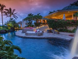 Beautiful waterfall feature and pool at twilight, jacuzzi grotto under the waterfall!