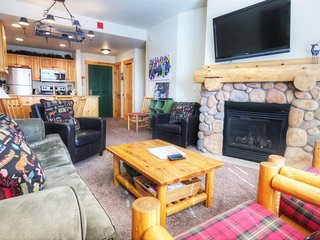 """SkyRun Property - """"TM407BR1 Tucker Mtn Lodge"""" - Living Room - The sofa in the living room pulls out to a queen size bed to sleep 2 additional people."""