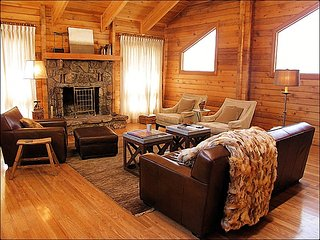 Fine Furniture, Natural Light, Vaulted Ceilings, & a Wood Fireplace make this an inviting space.