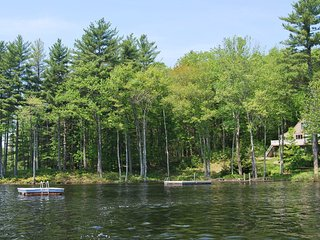 View of lake, dock, float and yard