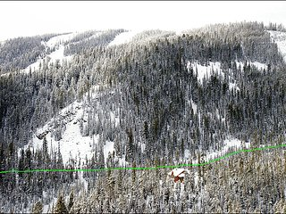 Exterior View of the home and slopes with the ski in ski out trail highlighted.