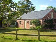 LITTLE PENTRE BARN, character holiday cottage, with pool near Overton-on-Dee, Ref 1696