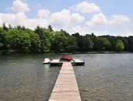 Captivating 2 Bedroom cottage offers amazing lakefront with a private dock!