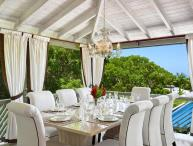 Attractive 4 bedroom villa, with an enticing infinity pool, swaying trees and Caribbean Sea beyond