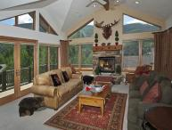 A vacation home rental in Vail featuring specially nice scenic mountain views, wrap-around decks and high-end finishes.