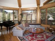 From this beautiful vacation home, you`ll especially enjoy the wrap-around deck and panoramic views.