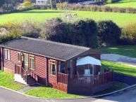 BRONWEN'S DEN, single-storey, detached lodge, pet-friendly, raised decked area