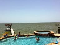 Spacious apt near Kemah,Texas;Bay views; fishing off the pier, WiFi, Cable, Pool