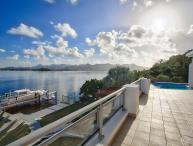 AMARYLLIS... Modern waterfront villa with boat dock and full AC, in gated community close to Mullet Bay beach