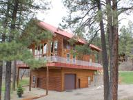 Red Top Lodge is a luxury vacation home in the San Juan River Village.