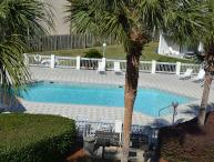 2 BR ACROSS STREET FROM BEACH BUDGET PRICED !