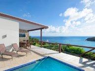A modern 3-bedroom, 2-bathroom beauty overlooking beach/vast views of the ocean