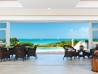 The open design of the luxury holiday home allows a view of the Caribbean Sea from every room
