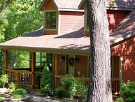 Secluded Woodsong Cottage!!! 2 br with a hot tub!  Foosball Table! In Woods