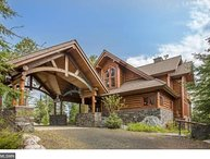 Eagle Point: Elite Wilderness Log Home with Welcoming Porte Cochere and Grand Views of the Lake!