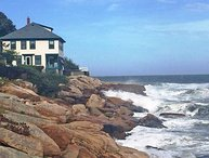 Perched on the ocean's edge with unobstructed views of the Twin Lights.