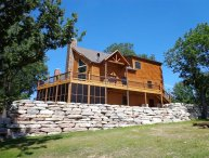Luxury Lakefront Log Chalet-Boatslips~Two Luxury Pools~Private Hot Tub!