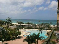PROMO-BEACHFRONT- EAGLE BEACH - OCEANIA RESORT -Glamour View Studio condo - E422