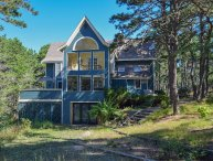 #312: Dreaming of an escape? Modern home is nestled in the woods of Wellfleet.