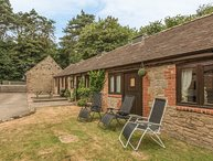 SPINNEY RETREAT, pet friendly, luxury holiday cottage, with a garden in