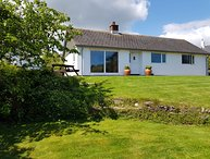 ORCHARD VIEW, secluded detached bungalow with wood burning stove and table