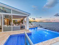 AMARYLLIS...  Modern 5 BR waterfront villa, boat dock, full AC, close to Maho &